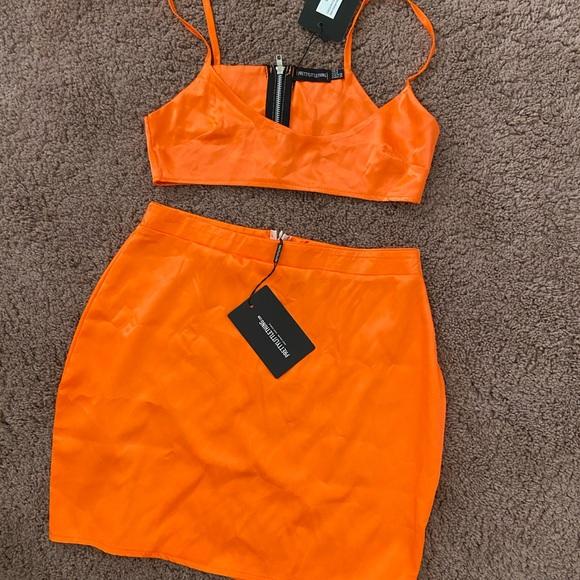 Neon orange mini skirt and crop top set